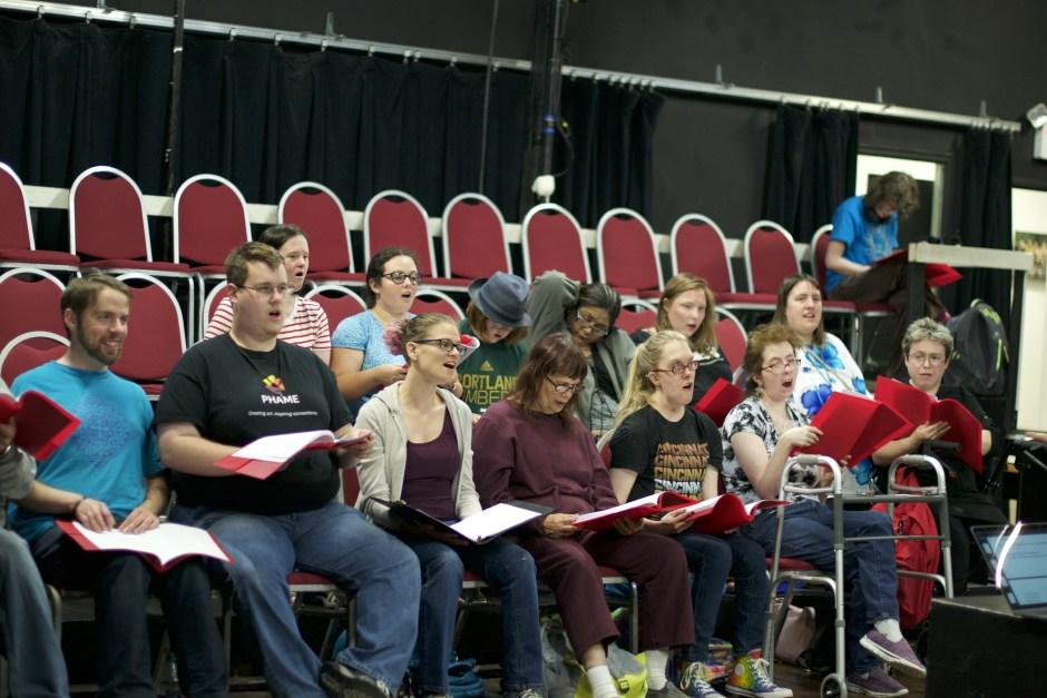 'The Poet's Shadow' chorus in rehearsal.