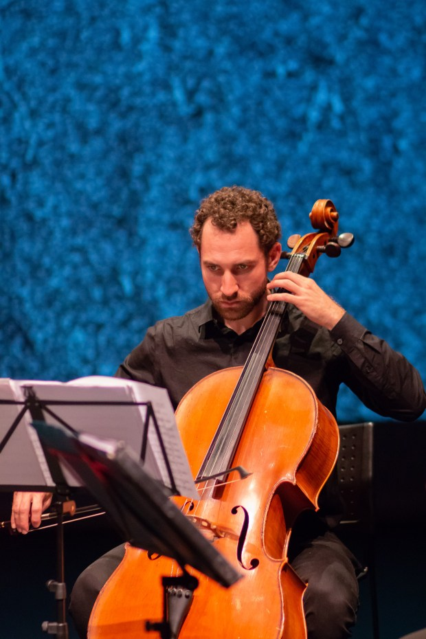 Delgani String Quartet cellist Eric Alterman at 'Local Sounds' dress rehearsal. Photo by Kelli Matthews.