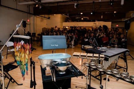 "Percussion and audience at Third Angle's ""Homecomings"" concert at New Expressive Works, October 2017. Photo by Kenton Waltz."