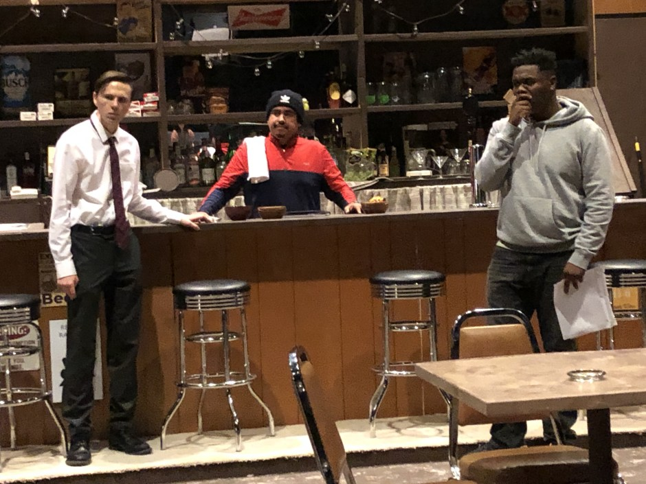 "Sam Hannigan as ""Jesse"" (left), Edgar Lopez as ""Oscar"" (center), and Isaiah Alexander as ""Chris"" rehearse a scene from Lynn Nottage's ""Sweat,"" which opens Thursday at Linfield College in McMinnville. Photo courtesy: Linfield College Theatre."