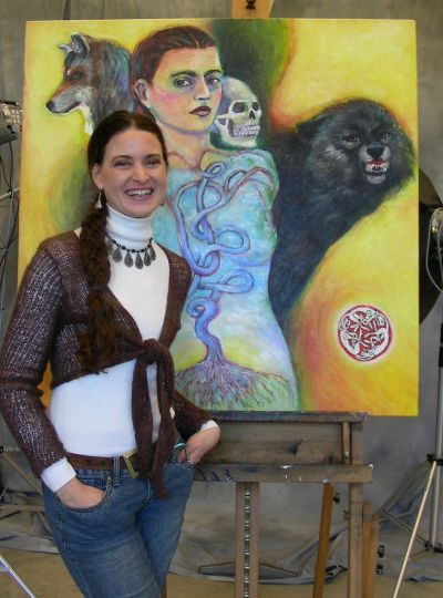 Kristin Schauk, shown here with self-portrait, says she cannot  imagine being an educator without being an artist, and vice versa. Photo courtesy: Clatsop Community College