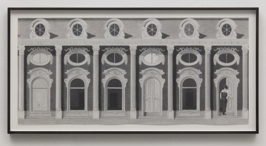 Framed graphite drawing of ornate neoclassical building facade featuring fluted columns and arched windows, with a figure seen from behind walking through a door on the far right.