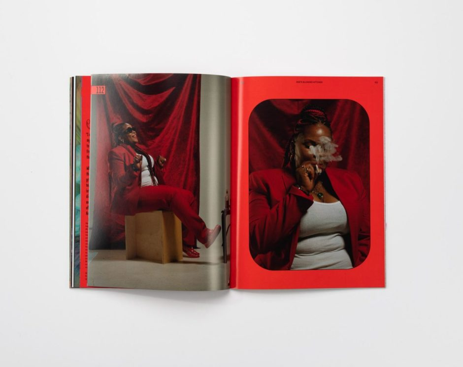 woman in red pant suit smoking cigarette in a magazine