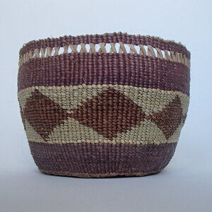 """The Chehalem Cultural Center is showing basketry by Sara Siestreem (Hanis Coos). The artist writes that she gathered and prepared all the materials for this Coos ceremonital cooking basket, which she calls """"taxai loʔloʔ t'see məʰkməʰk kwansəm"""" (huckleberry pie forever)."""