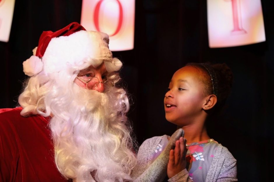 Belle Kea has a heart-to-heart with Santa during last year's holiday celebration at the Lincoln City Cultural Center. Photo courtesy: Lincoln City Cultural Center