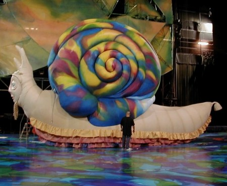 "Paul Polson has created giant inflatable sculptures for parades, rock bands, and Broadway. This colorful snail appeared in Cirque du Soleil's ""Mystère"" show. Photo courtesy: Paul Polson"
