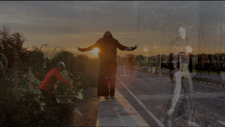 still from a dance video by Sophia Wright Emigh and Jaleesa Johnston. Three figures at sunset on an empty road.