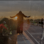 still from Bodies Apart, Moving Together - Three figures in the middle of a road