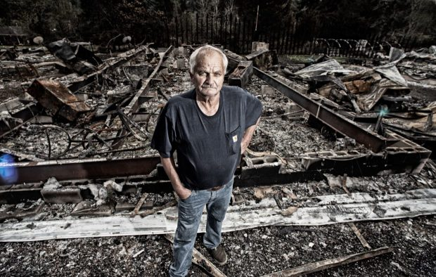 Bruce MacGregor photographed Larry on Sept. 20, after his Otis home was destroyed in the Echo Mountain fire, then looted. Photo by: Bruce MacGregor