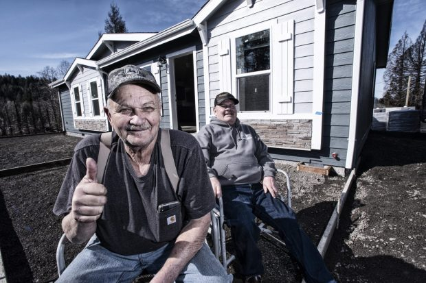 On March 16, Bruce MacGregor met up with Larry in Otis. Larry (left) was waiting for a cement truck and crew to lay a sidewalk to go with his new mobile home. Photo by: Bruce MacGregor