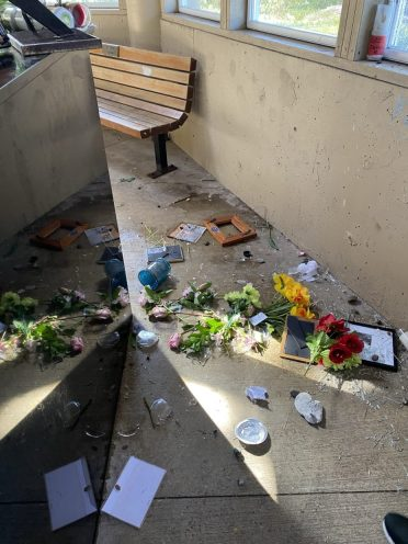 Vandals last month broke windows, destroyed vases, and threw flowers and mementos around the Newport Fishermen's Memorial Sanctuary. Photo by: Taunette Dixon