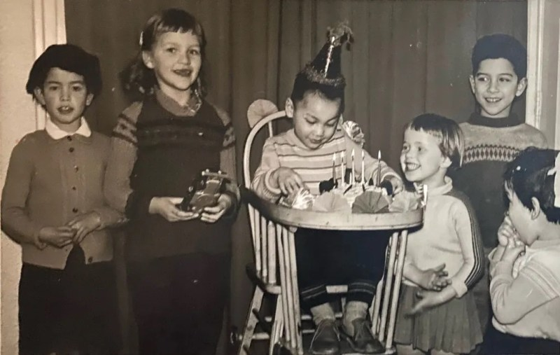Mantiri (far left) attends a birthday party in the Netherlands in 1960, the year she came to the United States, with Indo and Dutch children mingling. Indo families had an open-door policy welcoming in all the neighbors, but white families did not welcome Indos into their homes. Photo courtesy: Mantiri Family Archives
