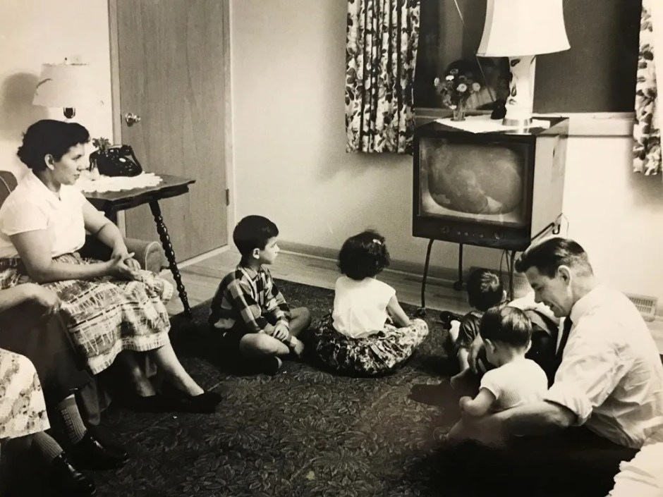 Soon after their arrival in the U.S. in 1960, this photo of Mantiri's family in their living room appeared in the Milwaukee newspaper in an article about the local Presbyterian Church sponsorship of the Mantiris as part of a refugee resettlement project. All the furniture was donated by church members. Photo courtesy: Mantiri Family Archives