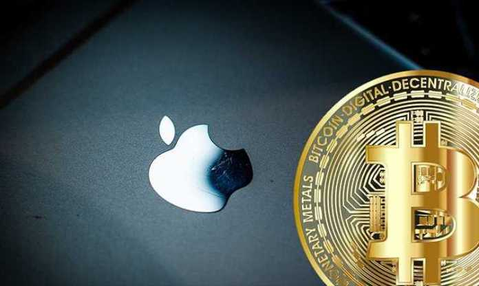 Picture of a gold bitcoin next to an Apple device, depicting Coinbase adding Apple Pay