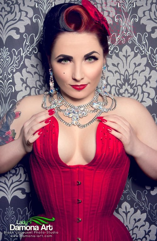 Miss Anne Thropy wears a red silk longline overbust.