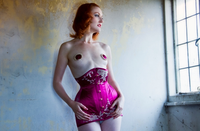 Model wearing corset dress