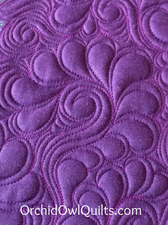 Feather swirl quilting
