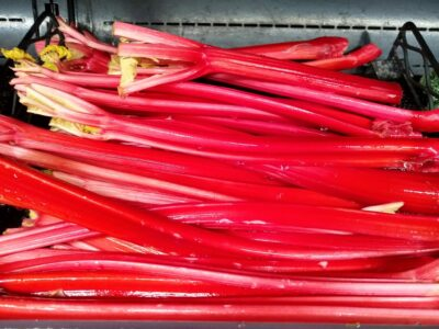 Rows of rhubarb stacked at the grocery store just ready to be made into rhubarb cheesecake!