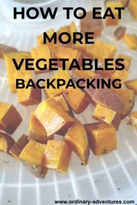 Cubed sweet potatoes on a tray. Text reads: How to eat more vegetables backpacking