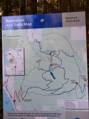 A picture of a trailhead map of the Oyster Dome trail loop