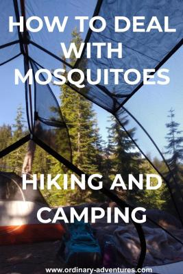 A photo taken inside a backpacking tent to deal with mosquitoes. In the foreground is a backpack and a jacket as well as another tent. The campsite is surrounded by evergreen trees and a blue sky day. Text reads: how to deal with mosquitoes hiking and camping