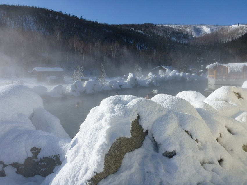 March is the best time to visit Fairbanks Alaska to enjoy the wintry hot springs surrounded by icy and snowy rocks