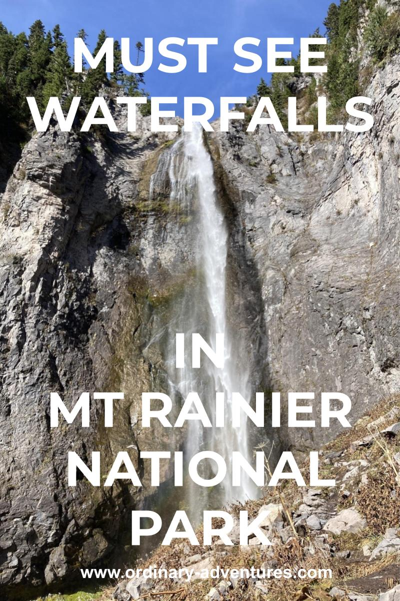 A narrow high waterfall coming down a cliff face. There are trees at the top of the cliff. Text reads must see waterfalls in mt rainier national park