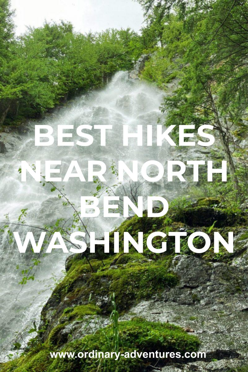 A view up from the base of a high misty waterfall tumbling over rocks. There are green trees around the rocks on the sides and above the waterfall. Text reads: best hikes near north bend washington
