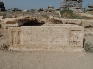 Ancient tomb with Greek writing.