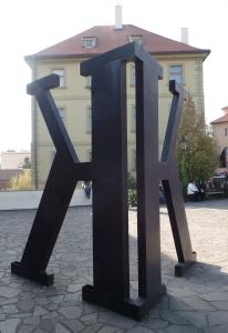 K statue outside the Franz Kafka Museum