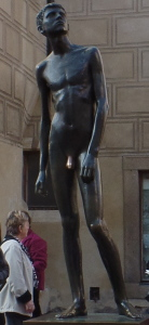 Boy statue with his penis aglow.