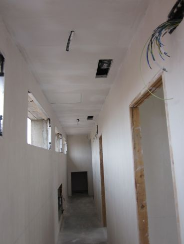 Guest corridor ceilings are put in