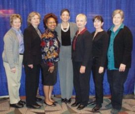 PONM members (Hazel on the right) with Standolyn Robertson (middle), NAPO President, at 2011 NAPO Conference.