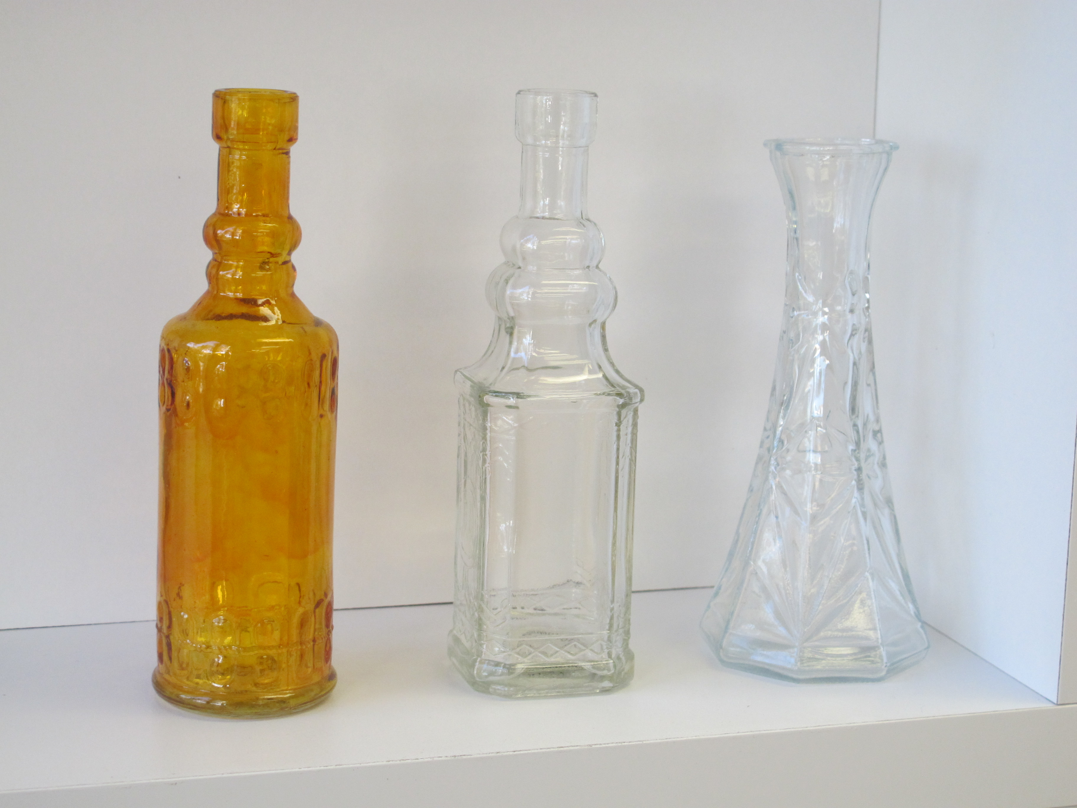 Bottles of Various Colors and Cuts