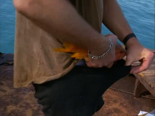 Tom Waits puts a fish in his pants.