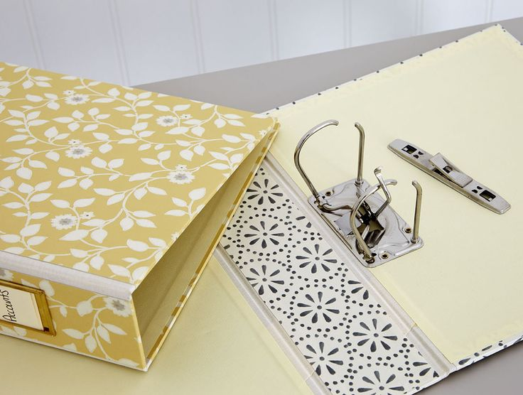 organise paper bills using a lever arch file