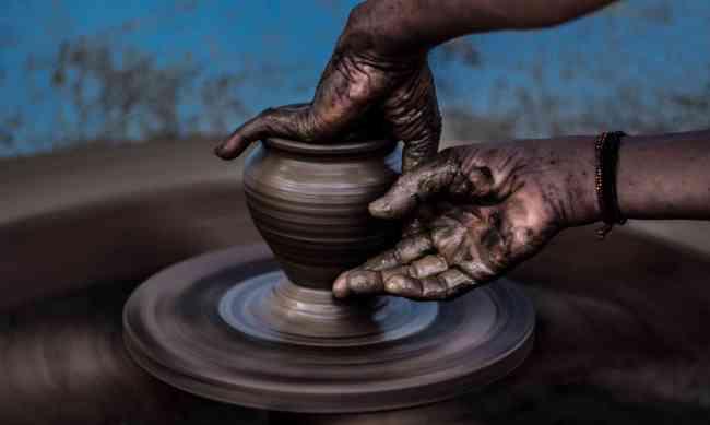 Molding flexible clay on pottery wheel
