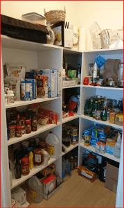 disorganized condo pantry