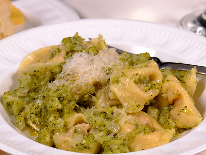 tortellini with a butter, garlic, onion and broccoli sauce