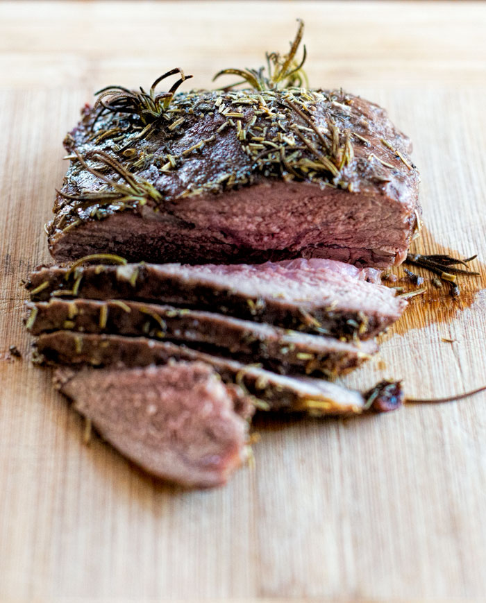 Lamb sirloin roast on a cutting board.