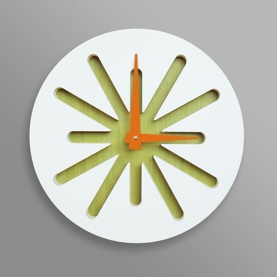 White splat on green bamboo clock