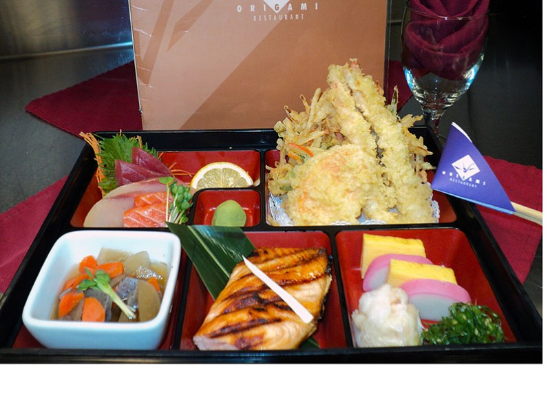 """Dating back to the Edo Period of Japan (1603 to 1867), The Makanouchi Bento (""""Between-Act Bento"""") was popularly served to theater goers in between intermissions of Noh and Kabuki performances. The Makanouchi Bento, highlights the many aspects of traditional Japanese cuisine that Origami provides."""