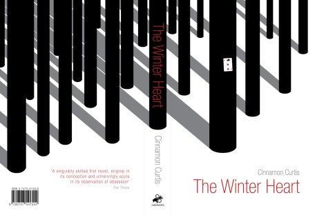 The Winter Heart book cover - full jacket layout. Stylised black tree trunks in a blank snowy landscape. One tree has a 3 of Hearts playing card pinned to it's trunk.