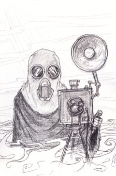 A small, robed figure wearing a gas-mask-like cowl stood behind an old camera-type contraption on a tripod