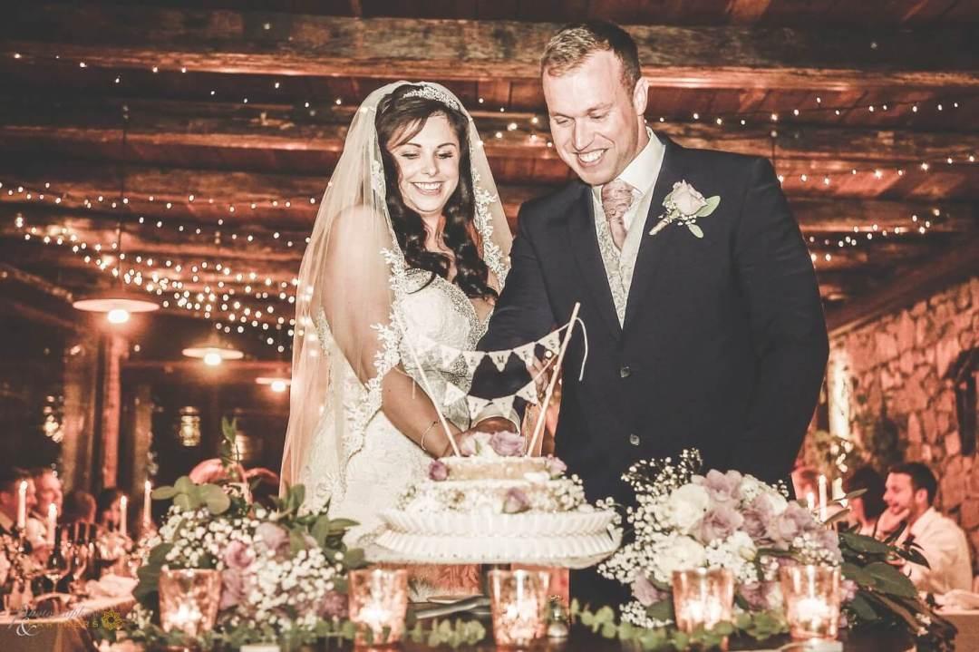 cutting the cake tuscany wedding