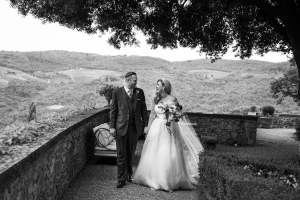 Whitney & Micheal walk in the garden of the Castle