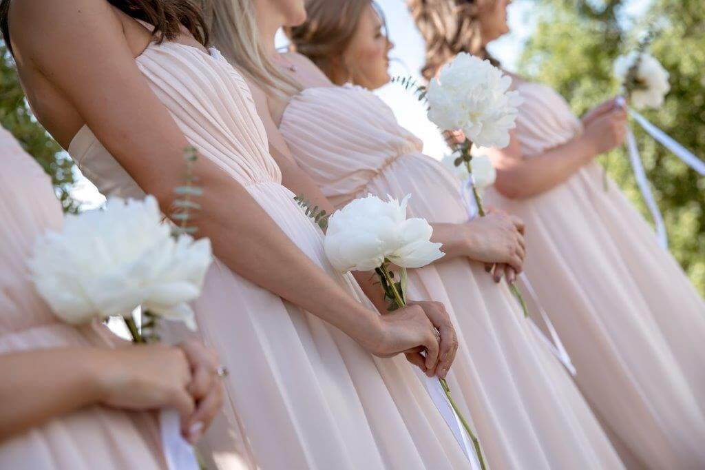 The bridesmaids attend the ceremony