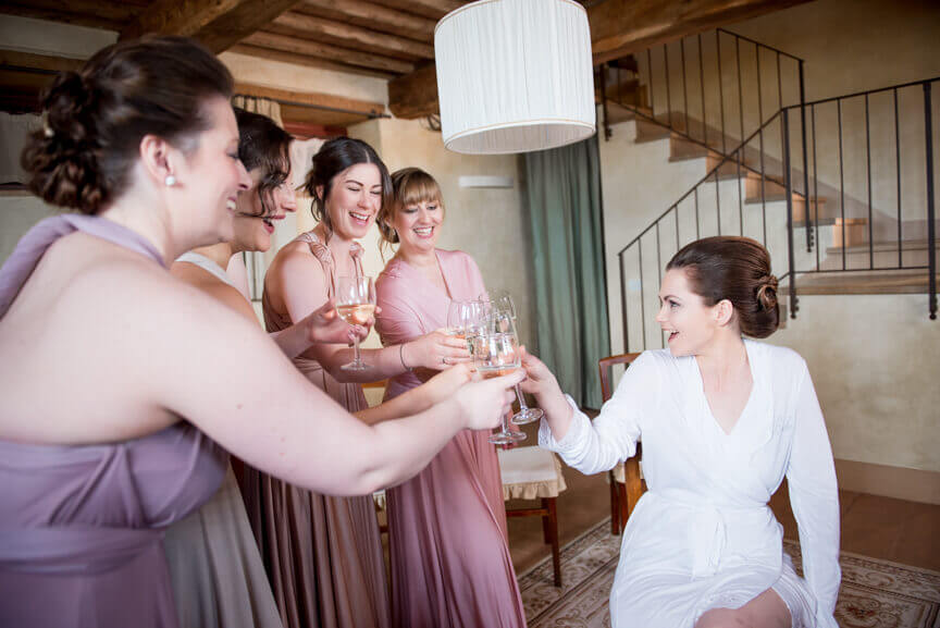 The bride cheers with the bridesmaids