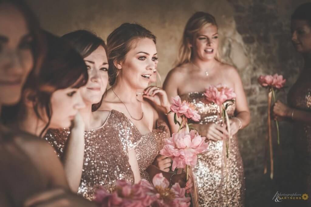 Bridesmaids get excited when they see the bride