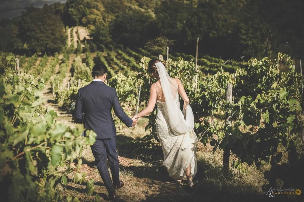 Sarah & Brett walk through the vineyard